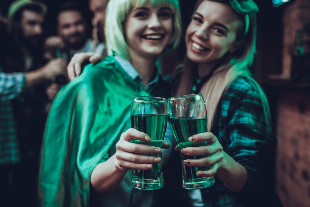 Friends Celebrating A Saint Patrick's Day At Pub
