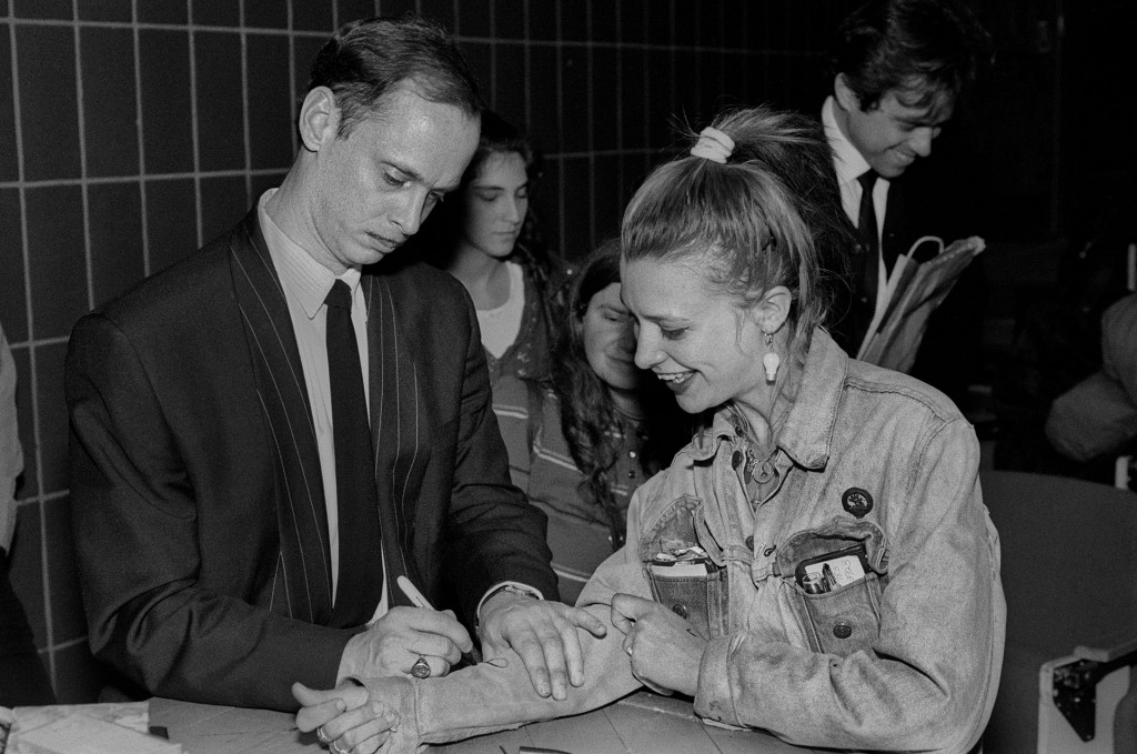 John Waters Signing A Fan's Jacket
