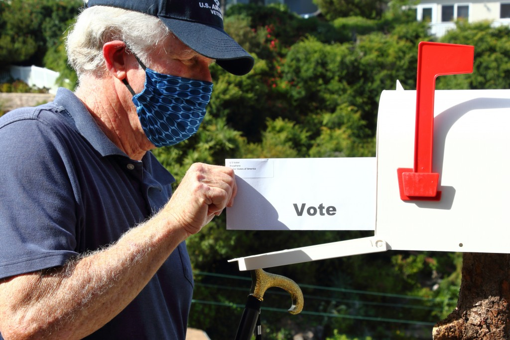 Elderly Man Voting By Mail