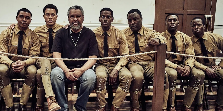 """University of Kansas film professor and Oscar winner Kevin Willmott is pictured with cast members of """"The 24th."""" // Photo courtesy Free State Festival"""