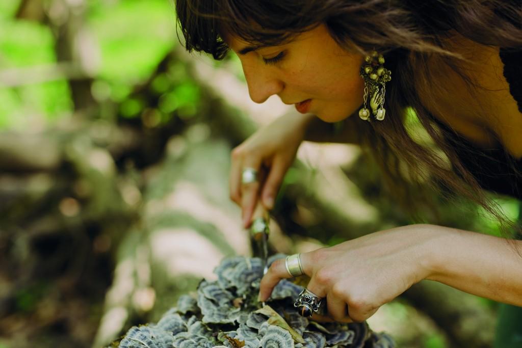 Laurena Harvests Some Turkey Tail Mushroom.