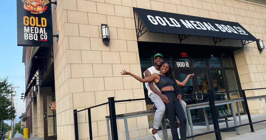 A photo of the owners and exterior of Gold Medal Bbq in Lawrence