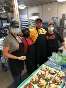 Volunteers working alongside Thelma's Kitchen Cook Artis Grigsby (3rd from right). // Photo courtesy Thelma's Kitchen