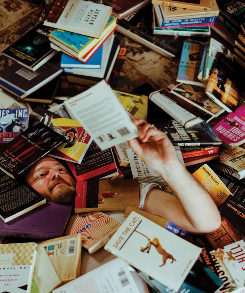 Brock and his books. // Photo by Travis Young