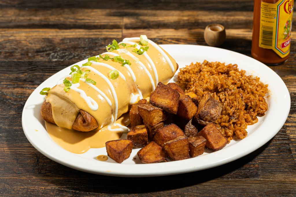 The fried breakfast burrito with fried potatoes and dirty rice. // Photo by Zach Bauman